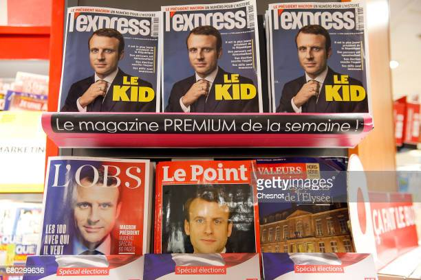 A rack displays French magazines front covers for 'L'Express' 'Le Point' and ''L'Obs' with the picture of the newly elected French president Emmanuel...