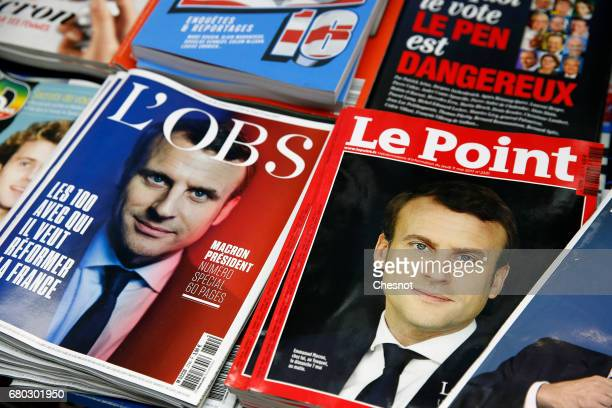 A rack displays French magazines front covers 'Le Point' and 'L'Obs' with the picture of the newly elected French president Emmanuel Macron a day...
