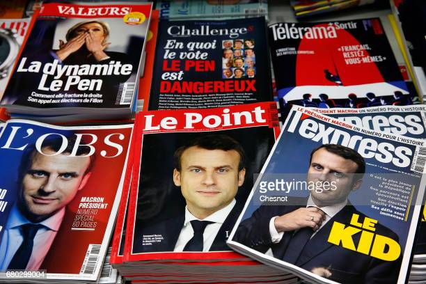 A rack displays French magazines front covers L'Express Le Point and L'Obs with the picture of the newly elected French president Emmanuel Macron a...