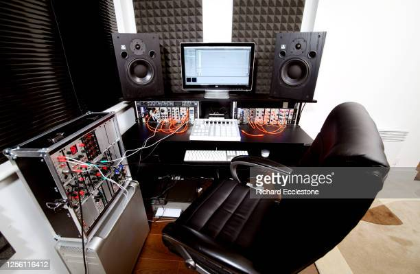Rack mounted effects processing units and synthesizers in use in a digital recording studio control room by Kirk Degiorgio better known as As One...