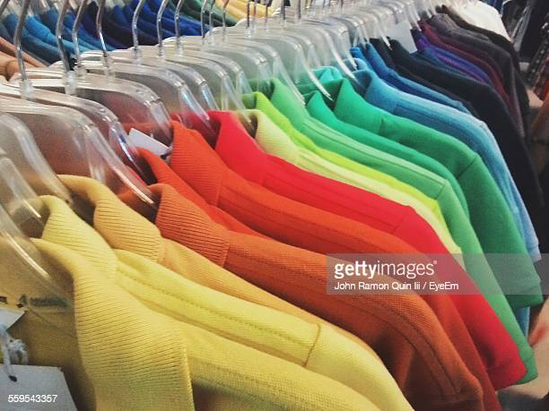 Rack Of Colored T-Shirts Displayed For Sale In Store