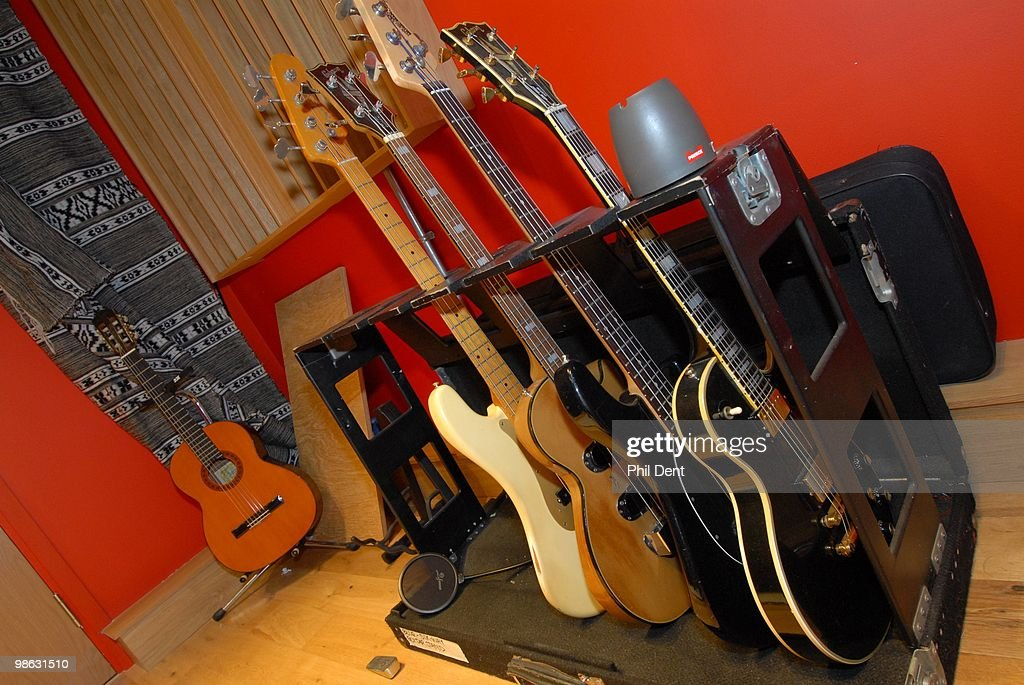 A rack of guitars and bass guitars at the Paint Factory recording studio on 22nd October 2008 in the United Kingdom.