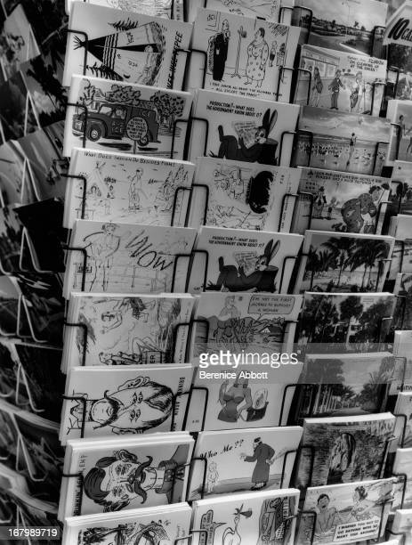 A rack of humourous postcards USA 1954