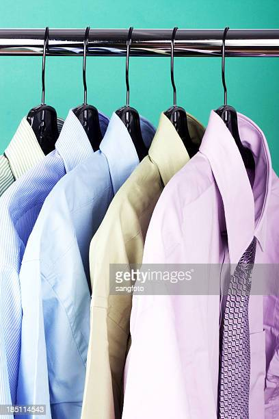 rack of men's hanging shirts and ties - shirt and tie stock pictures, royalty-free photos & images