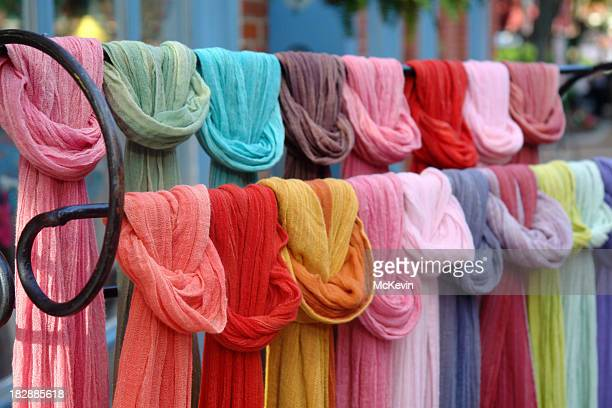 Rack of multicolored hip scarves