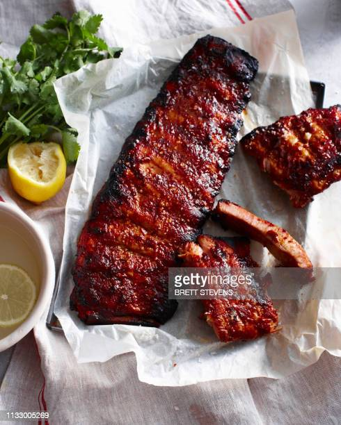 rack of sticky pork ribs with lemon - sparerib stock photos and pictures