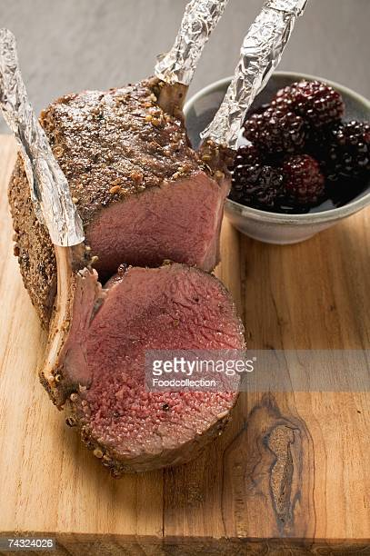Rack of venison, partly carved, with blackberries