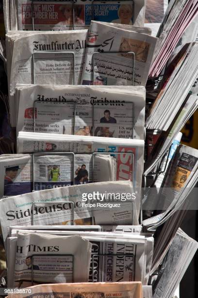rack with international newspapers, seville, spain - news stand stock pictures, royalty-free photos & images