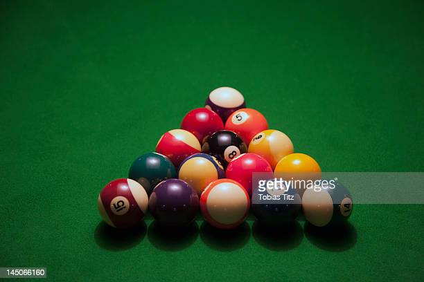 Racked pool balls on a green felt pool table