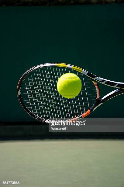 Racket hitting a ball