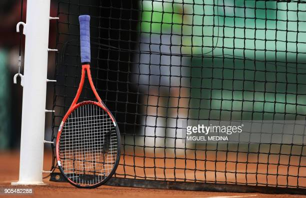A racket is seen as Britain's Andy Murray plays against Serbia's Viktor Troicki during their men's fourth round match in the French Open tennis...