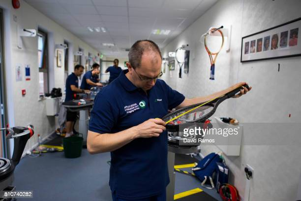A racket stringer messures a restrung racket day six of the Wimbledon Lawn Tennis Championships at the All England Lawn Tennis and Croquet Club on...
