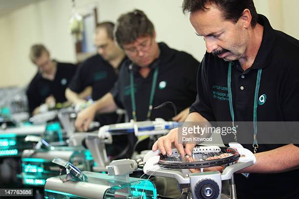 Racket stringers restring players rackets on day eight of the Wimbledon Lawn Tennis Championships at the All England Lawn Tennis and Croquet Club on...