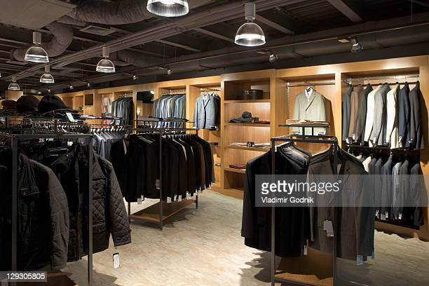 racks of clothes in a menswear store - men fashion stock photos and pictures
