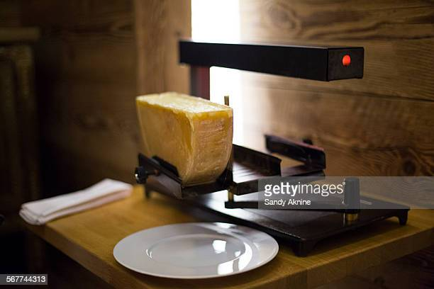 Raclette cheese on grill, Crans-Montana, Swiss Alps, Switzerland
