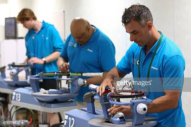 Racquet stringers work on day 8 of the Wimbledon Lawn Tennis Championships at the All England Lawn Tennis and Croquet Club on July 7 2015 in London...