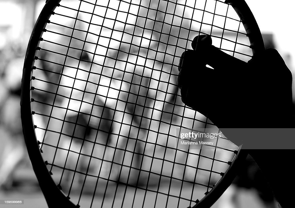 A racquet technician makes sure the racquet strings are straight in the stringers' hut at the 2013 Australian Open at Melbourne Park on January 17, 2013 in Melbourne, Australia.