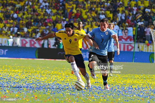 Radalmel Falcao of Colombia and Cristian Rodriguez of Uruguay fight for the ball during a match between Colombia and Uruguay as part of the South...