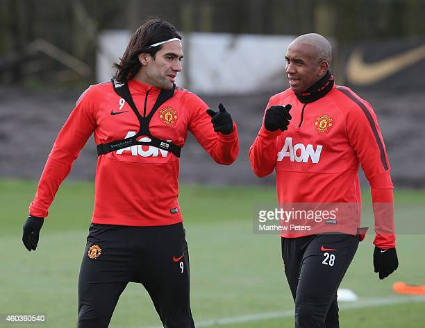 Radamel Falcao and Anderson of Manchester United chat during a first team training session at Aon Training Complex on December 11 2014 in Manchester...