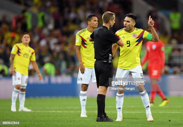 Radamel Falcao and Carlos Bacca of Colombia argue with Referee Mark Geiger during the 2018 FIFA World Cup Russia Round of 16 match between Colombia...