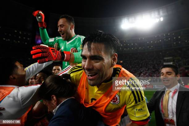 Radamel Falcao and David Ospina of Colombia celebrate with teammates the qualifying to the World Cup Russia 2018 after the match between Peru and...