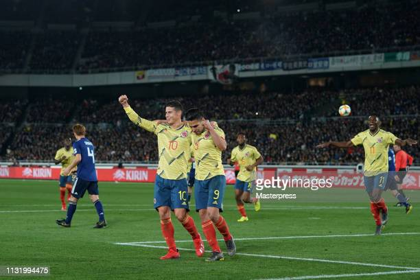Radamel Falcao and James Rodoriguez of Colombia celebrates a scored goal from the penalty spot during the international friendly match between Japan...
