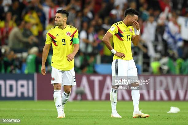 Radamel Falcao and Johan Mojica of Colombia show their dejection following the 2018 FIFA World Cup Russia Round of 16 match between Colombia and...