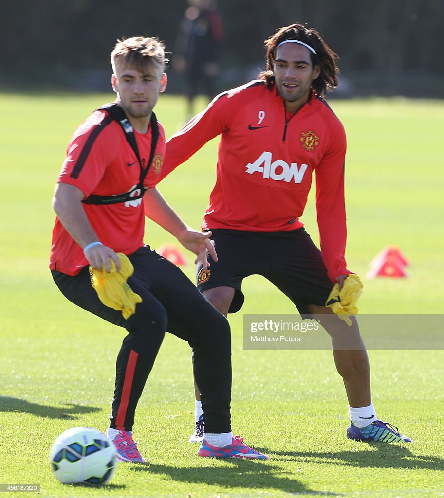 Radamel Falcao and Luke Shaw of Manchester United in action during a first team training session at Aon Training Complex on September 26, 2014 in Manchester, England.