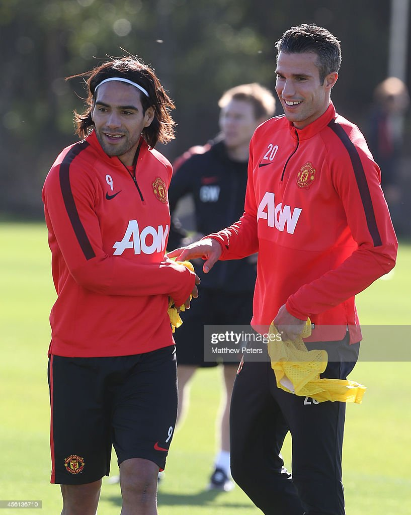 Radamel Falcao and Robin van Persie of Manchester United in action during a first team training session at Aon Training Complex on September 26, 2014 in Manchester, England.