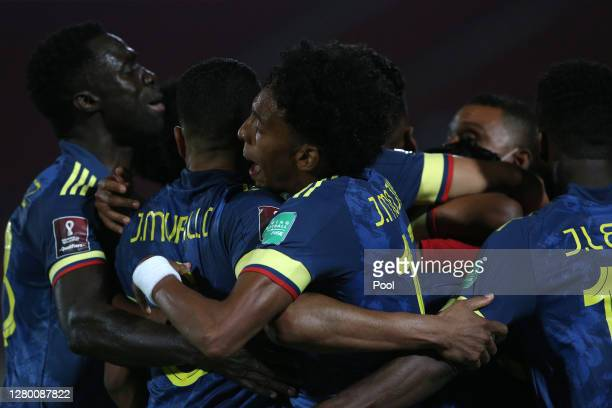 Radamel Falcao García of Colombia celebrates with teammates Jeison Murillo and Johan Mojica after scoring the second goal of his team during a match...