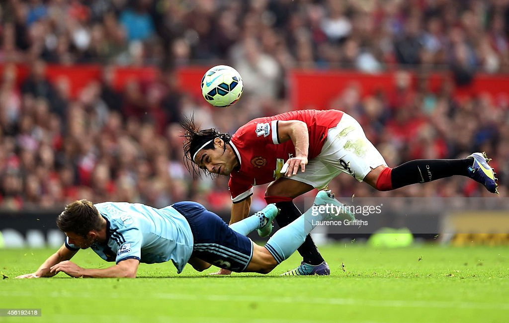 Radamel Falcao García of Manchester United and Aaron Cresswell of West Ham compete for the ball during the Barclays Premier League match between Manchester United and West Ham United at Old Trafford on September 27, 2014 in Manchester, England.