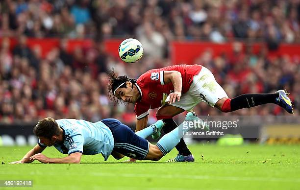 Radamel Falcao García of Manchester United and Aaron Cresswell of West Ham compete for the ball during the Barclays Premier League match between...