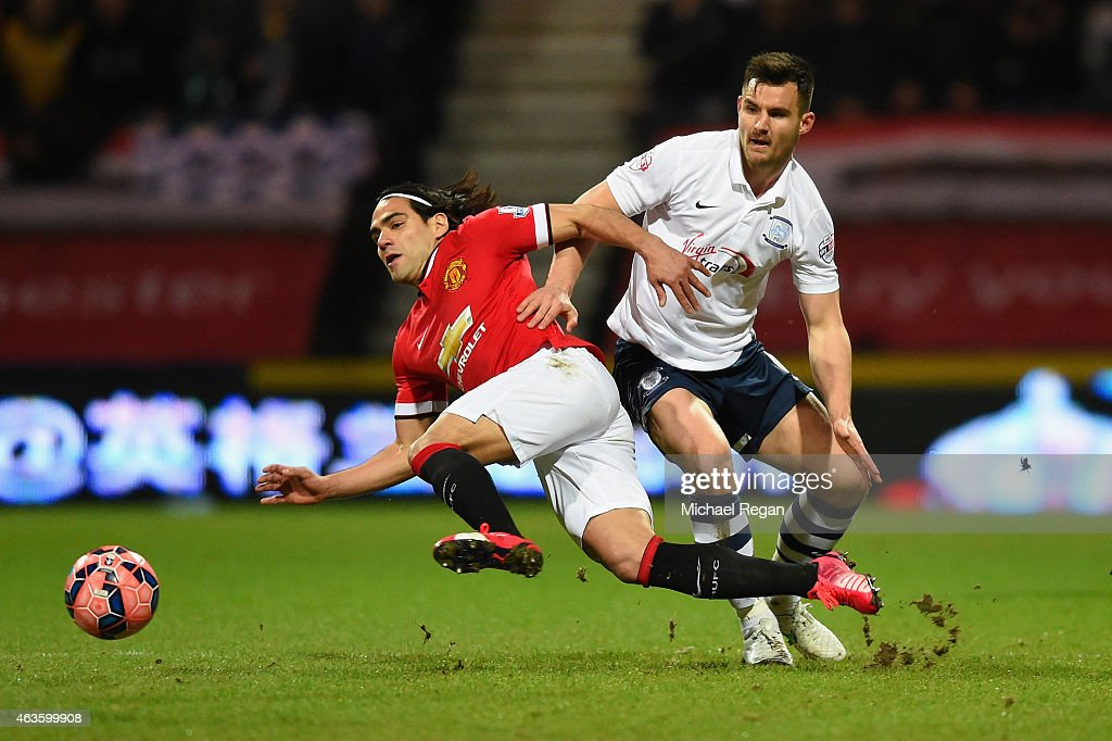 Radamel Falcao García of Manchester United and Bailey Wright of Preston North End battle for the ball during the FA Cup Fifth round match between Preston North End and Manchester United at Deepdale on February 16, 2015 in Preston, England
