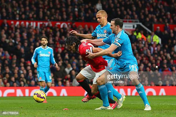 Radamel Falcao García of Manchester United is brought down in the area by Wes Brown and John O'Shea of Sunderland to win a penalty during the...