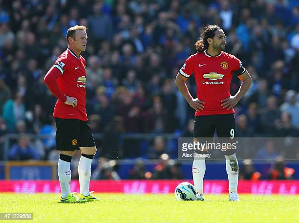 Radamel Falcao Garcia and Wayne Rooney of Manchester United look dejected as Kevin Mirallas of Everton scores their third goal during the Barclays...