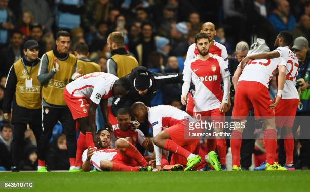 Radamel Falcao Garcia of AS Monaco celebrates as he with team mates as scores their third goal during the UEFA Champions League Round of 16 first leg...