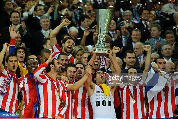 Radamel Falcao Garcia of Atletico Madrid lifts The UEFA Europa League Trophy after defeating Athletic Bilbao 30 in the UEFA Europa League Final 2012