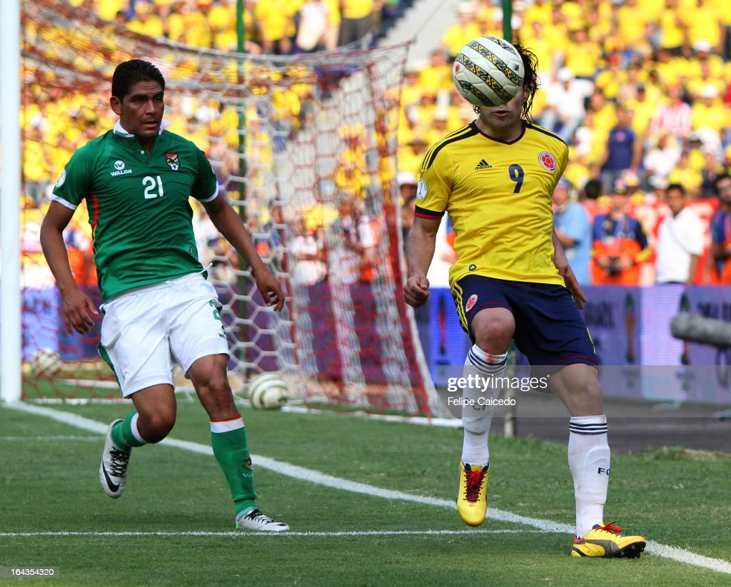 Radamel Falcao Garcia (R) of Colombia fights for the ball with Mauro Zenteno of Bolivia during a match between Colombia and Bolivia as part of the 11th round of the South American Qualifiers for the FIFA World Cup Brazil 2014 at the Roberto Melendez Metropolitan Stadium on March 22, 2013 in Barranquilla, Colombia. (Photo by Felipe Caicedo/LatinContent/Getty