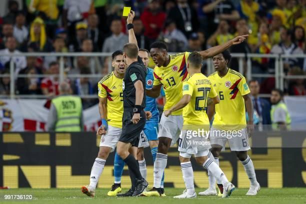 Radamel Falcao Garcia of Colombia referee Mark Geiger Colombia goalkeeper David Ospina Yerry Mina of Colombia Juan Quintero of Colombia Carlos...