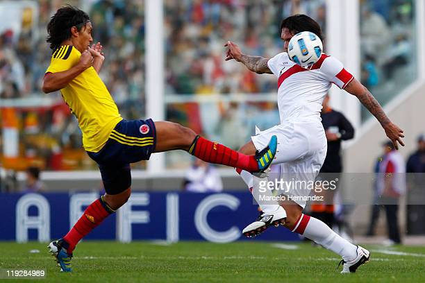 Radamel Falcao Garcia of Colombia struggles for the ball with Juan Vargas of Peru during a quarter final match between Colombia and Peru as part of...