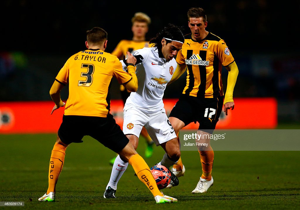 Radamel Falcao Garcia of Manchester United battles for the ball with Greg Taylor and Liam Hughes of Cambridge United during the FA Cup Fourth Round match between Cambridge United and Manchester United at The R Costings Abbey Stadium on January 23, 2015 in Cambridge, England.