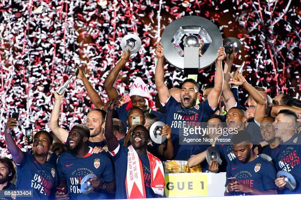 Radamel Falcao lift the trophy and players of Monaco celebrate winning the Ligue 1 title after the Ligue 1 match between As Monaco and AS Saint...