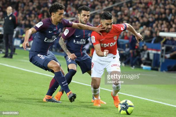 Radamel Falcao of AS Monaco in action against Marquinhos and Dani Alves of Paris SaintGermain in action during the Ligue 1 match between Paris Saint...