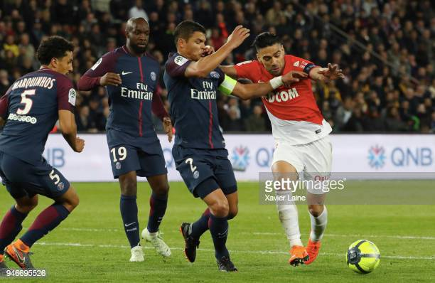 Radamel Falcao of AS Monaco in action against Thiago Silva and Lassana Diarra of Paris SaintGermain during the Ligue 1 match between Paris Saint...
