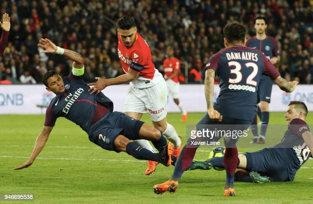 Radamel Falcao of AS Monaco in action against Thiago Silva Dani Alves and Giovani Lo Celso of Paris SaintGermain in action during the Ligue 1 match...