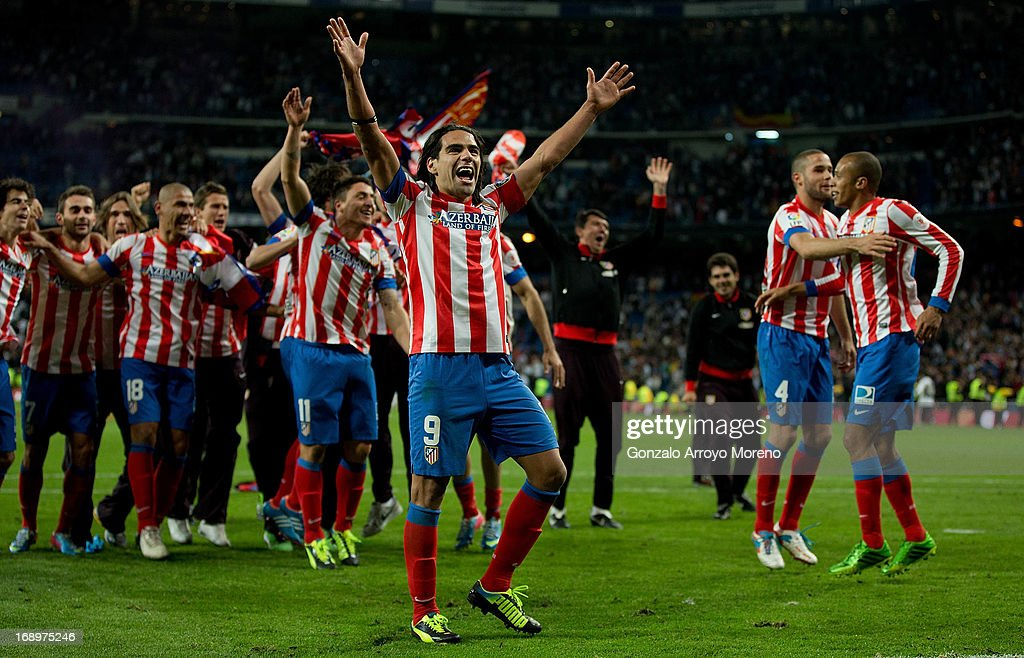Radamel Falcao of Atletico de Madrid celebrates winning the match with teammates after finishing the Copa del Rey Final match between Real Madrid CF and Club Atletico de Madrid at Estadio Santiago Bernabeu on May 17, 2013 in Madrid, Spain.