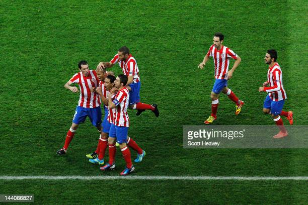 Radamel Falcao of Atletico Madrid celebrates scoring the opening goal with his team mates during the UEFA Europa League Final between Atletico Madrid...