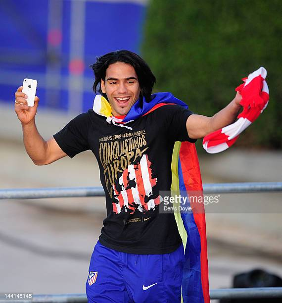 Radamel Falcao of Atletico Madrid celebrates with fans at Plaza Neptuno a day after Atletico won the Europa League Final on May 10 2012 in Madrid...