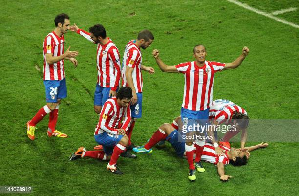 Radamel Falcao of Atletico Madrid celebrates with his team mates after scoring his team's second goal during the UEFA Europa League Final between...