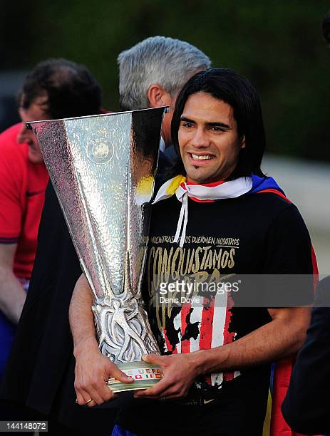 Radamel Falcao of Atletico Madrid holds the Europa League trophy while celebrating with fans at Plaza Neptuno a day after Atletico won the Europa...